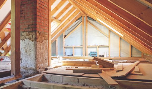 an interior view of a house attic under construction